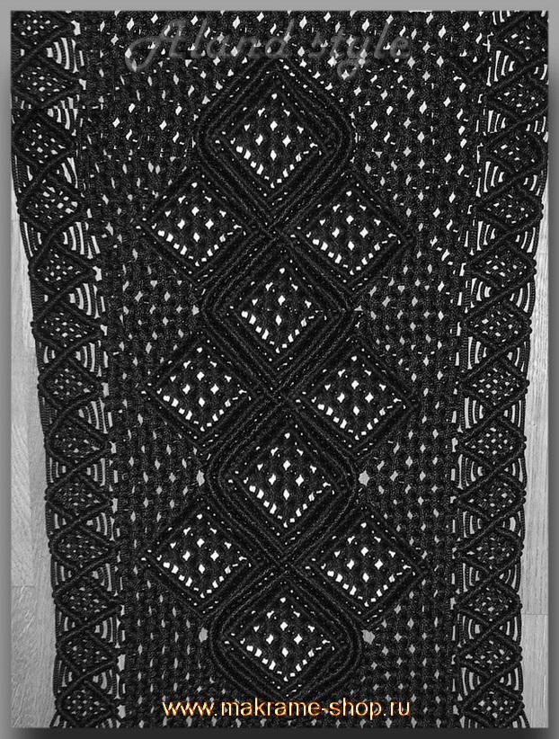 Узор черных плетеных накидок с эмблемой